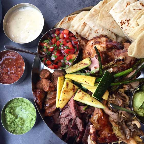Can't decide? This one has it all! A selection of all the meats we offer plus the veggies. Includes our hand-made tortillas, fresh guacamole, and more!